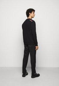 HUGO - DUNGIKU - Sweatshirt - black - 2