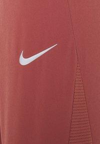 Nike Performance - PANT COOL - Pantalon de survêtement - canyon rust/reflective silver - 6