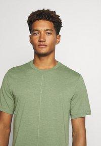 Nike Performance - DRY TEE YOGA - Basic T-shirt - galactic jade/oil green - 3