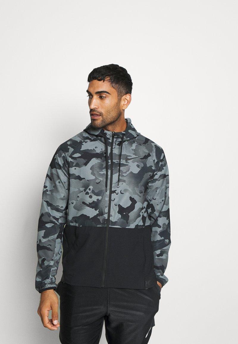 Nike Performance - Outdoor jacket - black/grey fog