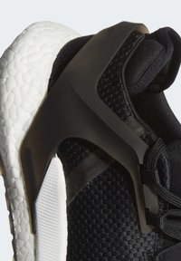 adidas Performance - ALPHATORSION BOOST SHOES - Neutral running shoes - black - 7