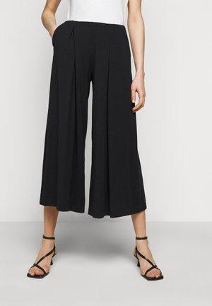 USSITA - Trousers - schwarz