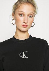Calvin Klein Jeans - CUT OUT BACK DRESS - Day dress - black - 3