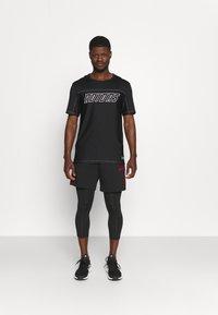 adidas Performance - Krótkie spodenki sportowe - black/scarlet - 1