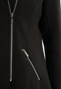 MS Mode - IN BIKERMODEL - Short coat - black - 6