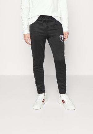 Teplákové kalhoty - nero