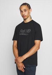Diesel - T-JUST-SLITS-X83 T-SHIRT - Print T-shirt - black - 0