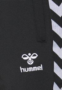 Hummel - NATHAN 2.0 TAPERED PANTS - Tracksuit bottoms - black - 6
