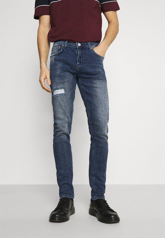 SMARTY - Slim fit jeans - dark blue denim