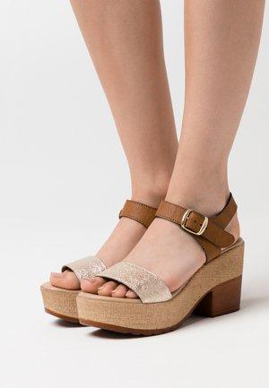High heeled sandals - platino