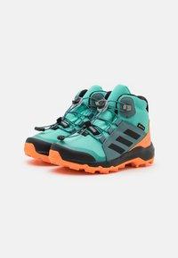 adidas Performance - TERREX MID GTX UNISEX - Hiking shoes - acid mint/core black/screaming orange - 1