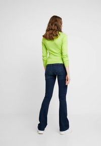 ONLY - ONLPAOLA - Flared jeans - dark blue denim - 2