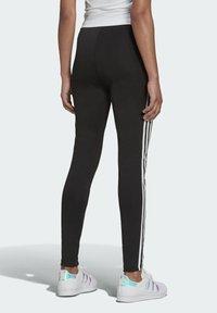 adidas Originals - Tracksuit bottoms - black - 1