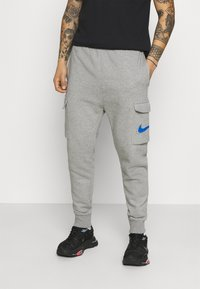 Nike Sportswear - COURT PANT - Tracksuit bottoms - grey heather - 0