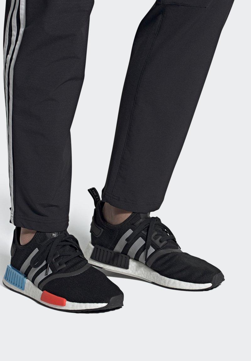 adidas Originals - NMD_R1 UNISEX - Trainers - core black/silver metallic/solar red