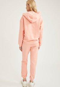 DeFacto Fit - Tracksuit bottoms - pink - 2