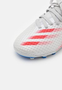 adidas Performance - X GHOSTED.3 MG UNISEX - Moulded stud football boots - halo blue/scarlet/core black - 5