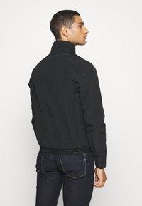 Calvin Klein - CASUAL BLOUSON JACKET - Summer jacket - black - 2