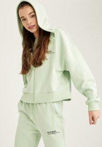 DeFacto - Zip-up hoodie - turquoise - 3