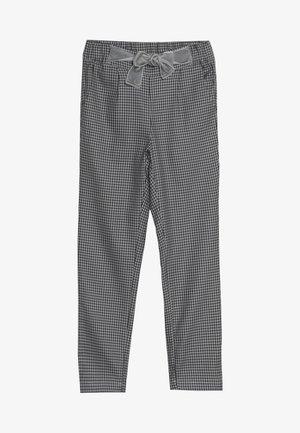 VAMILLA TROUSERS - Trousers - black/white