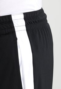 Jordan - ALPHA DRY - Sports shorts - black/white/white - 3
