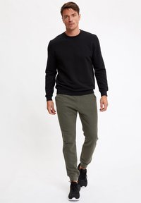 DeFacto - Spodnie treningowe - khaki - 1