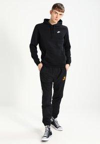 Nike Sportswear - CLUB HOODIE - Hoodie - black - 1