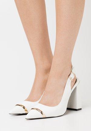 Escarpins à talons hauts - white