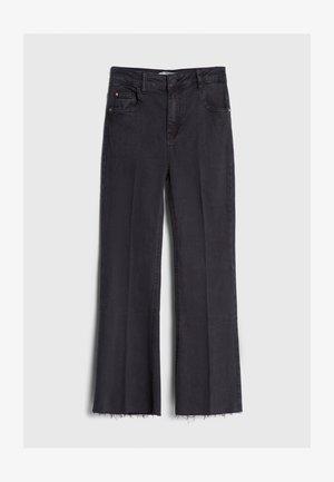 SCHLAGHOSE - Flared jeans - black