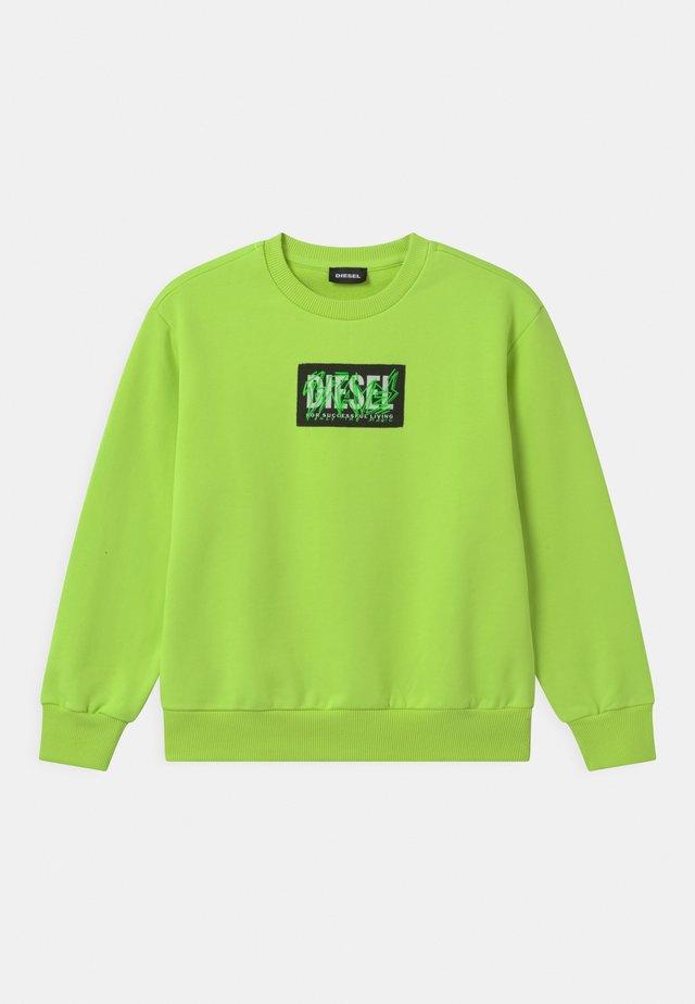 OVER UNISEX - Sweatshirt - lime fluo