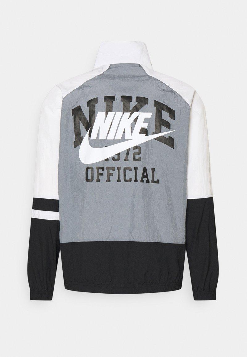 Nike Sportswear - Tunn jacka - cool grey