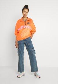 Nike Sportswear - Veste coupe-vent - atomic orange/black - 1