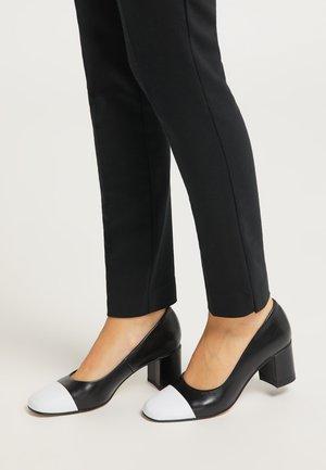 Classic heels - schwarz weiss