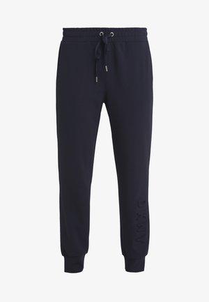 EMBOSSED LOGO - Teplákové kalhoty - new navy