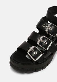Buffalo - VEGAN RAJA - Platform sandals - black - 7