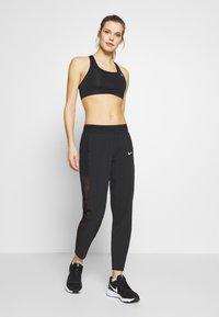 Nike Performance - PANT RUNWAY - Pantalones deportivos - black - 1