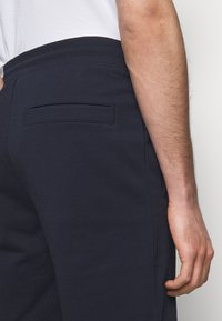 HUGO - Tracksuit bottoms - dark blue - 4