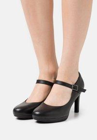 Clarks - AMBYR SHINE - Platform heels - black - 0