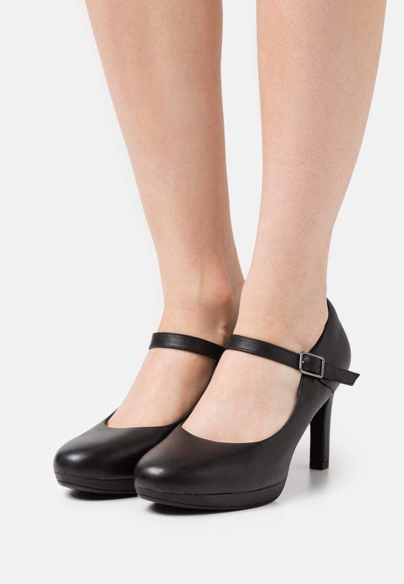 Clarks - AMBYR SHINE - Platform heels - black