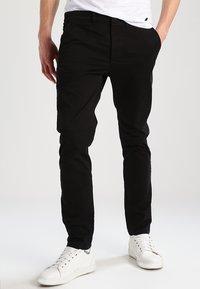 Jack & Jones - JJIMARCO JJENZO - Trousers - black - 0