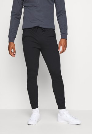 GOLF TRACK PANTS - Pants - true black