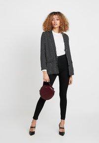 Vero Moda - VMJOY MIX - Jeans Skinny Fit - black - 1