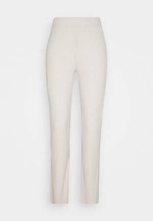 STINA TROUSERS - Tracksuit bottoms - sesame