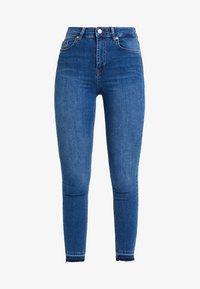 HIGH WAIST OPEN HEM - Jeans Skinny Fit - mid blue