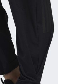 adidas Performance - STRETCHABLE WOVEN JOGGERS - Tracksuit bottoms - black - 5