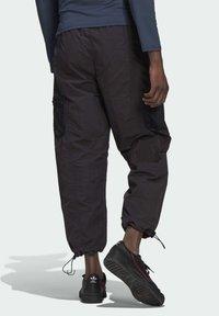 adidas Originals - ADV Woven PANTS ADVENTURE ORIGINALS REGULAR TRACK - Tracksuit bottoms - black - 2