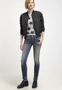 Replay - HYPERFLEX LUZ - Jeans Skinny Fit - stone blue - 1