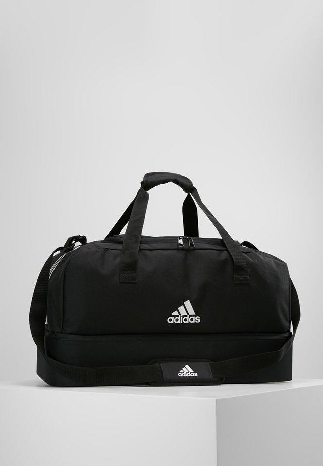 TIRO DU - Sports bag - black/white