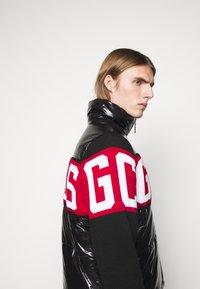 GCDS - LOGO MIX PUFFER - Winter jacket - black - 3