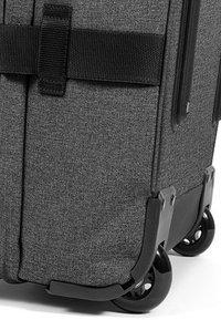 Eastpak - TRANVERZ L CORE COLORS - Wheeled suitcase - black denim - 6